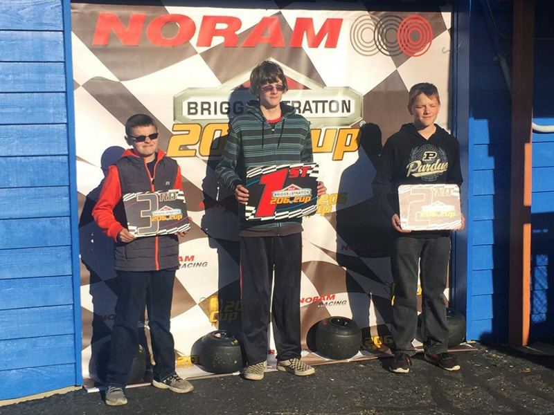 Logan Lohmar (center) and Jacob Bolen (left) on the 206 Junior podium at MRP (206 Cup Series photo)