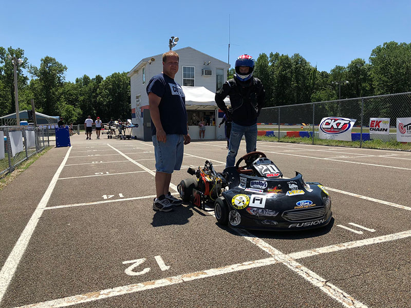 Justin Wishard readies to hit the track with his father, Tom, standing by