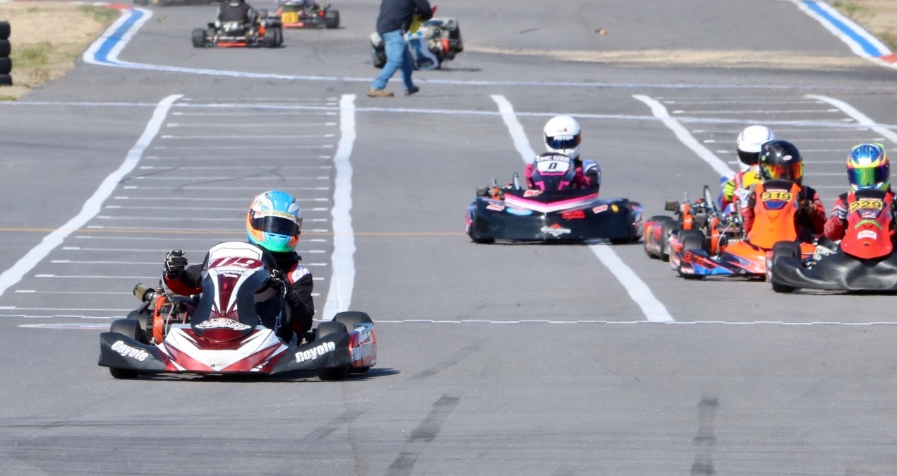 Owen Lloyd (119) crosses the finish stripe first in a hotly contested Junior final (Jon DeMaster photo)