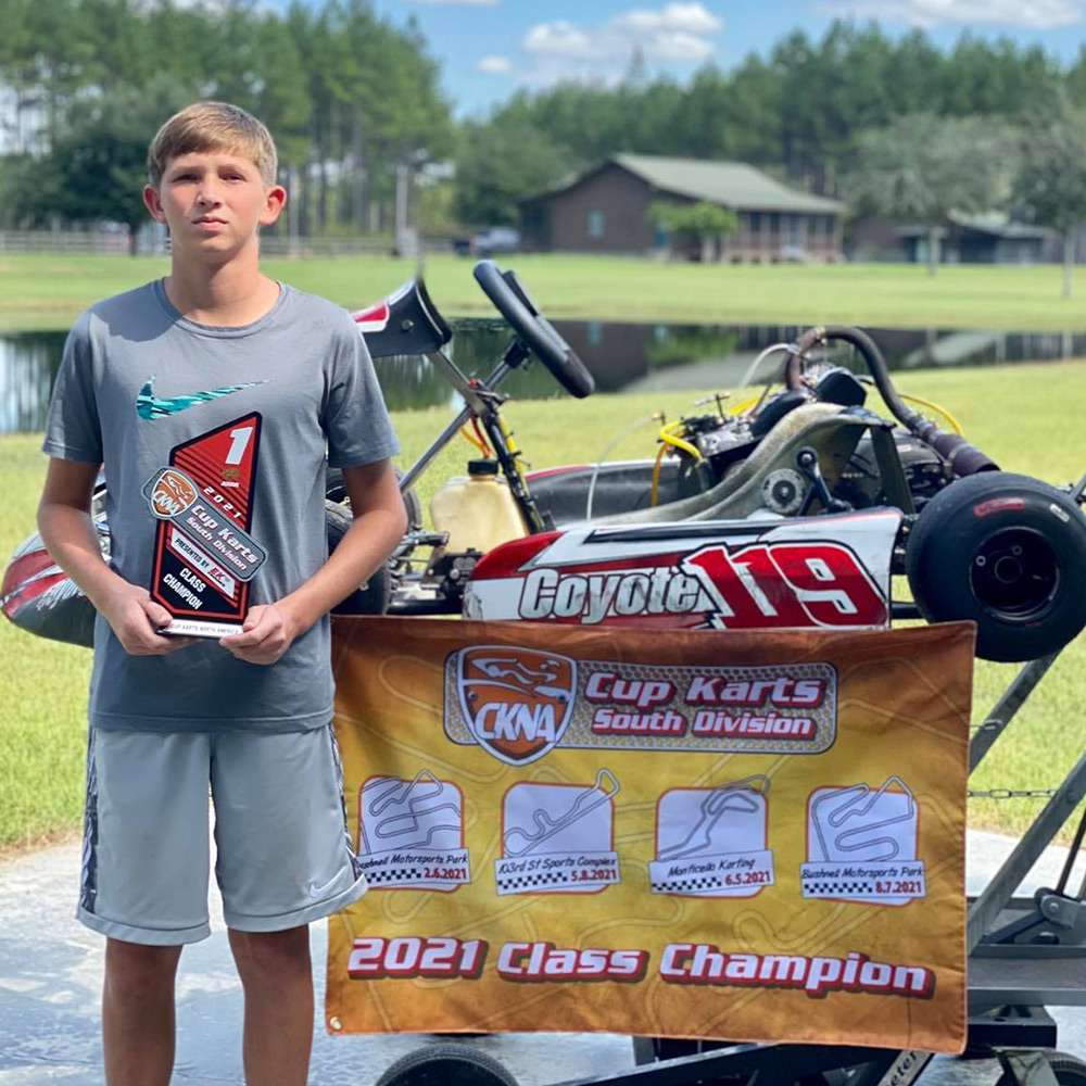 2021 Cup Karts South Junior champion Owen Lloyd and his 2021 Zenith chassis